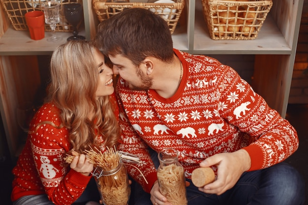 People in a christmas decorations. man and woman in a red sweater.