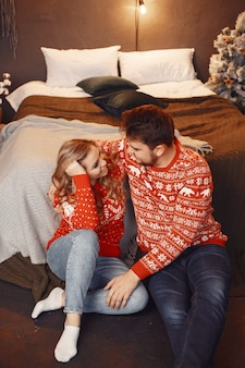 People in a christmas decorations. man and woman in a red sweater