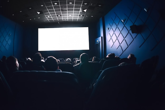 People in the cinema watching a movie.