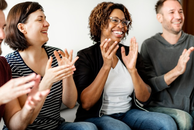 People clapping together