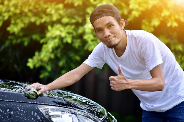 People cleaning car at home sunlight