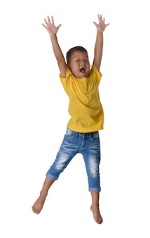 People concept happy little asian boy jumping in air happiness, childhood, freedom in movement