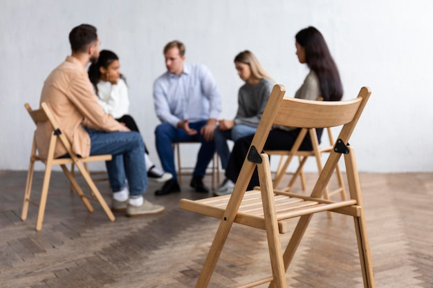 People conversing at a group therapy session