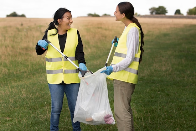 People doing community service by collecting trash in nature