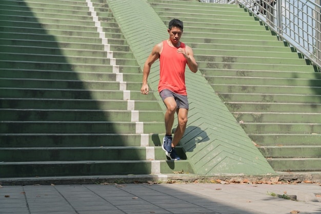 People doing exercises and warm up before running and jogging; healthy lifestyle cardio together at outdoors