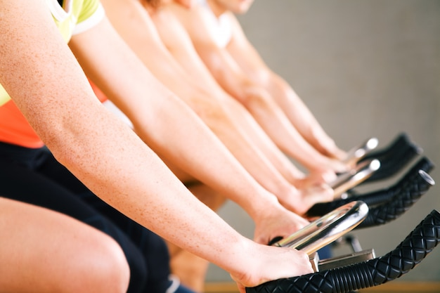People doing gym cycling