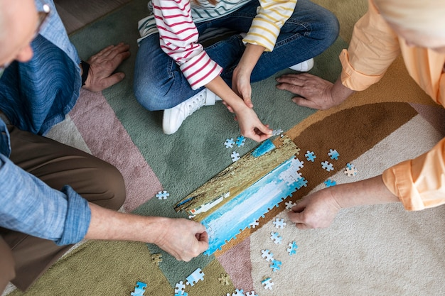 People doing puzzle on floor close up