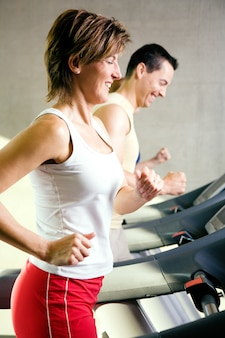 People doing treadmill exercises