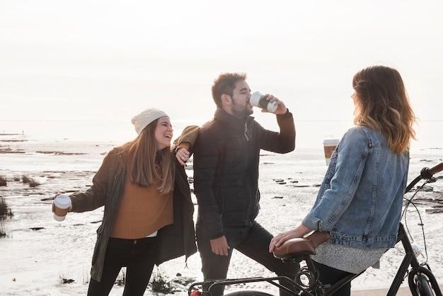 People drinking coffee on seashore