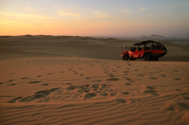 People enjoy dune buggy riding on huacachina desert in ica region of peru, south america