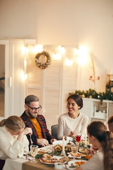People enjoying dinner on christmas