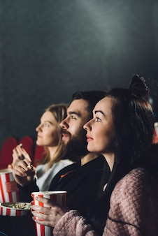People enjoying film in cinema