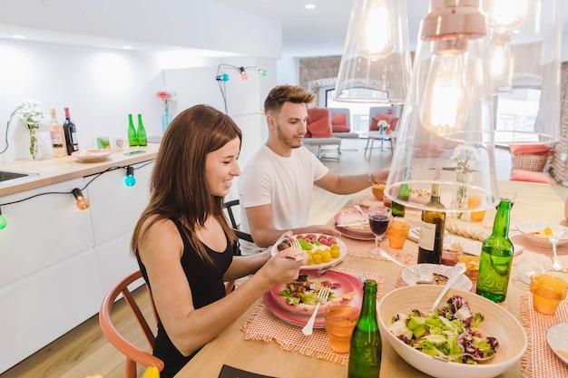People enjoying food at dinner