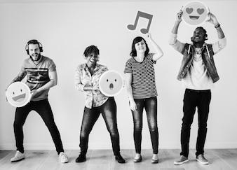 People enjoying music and emojis together