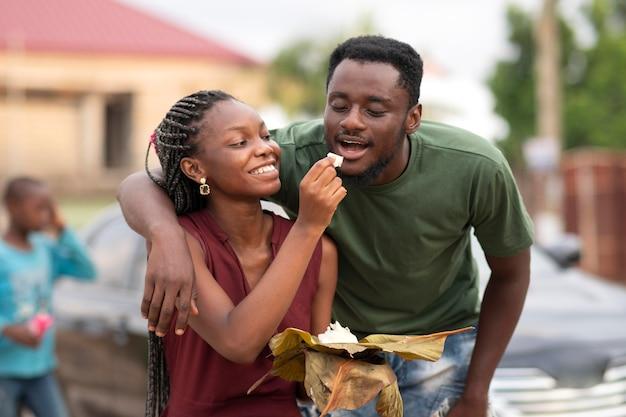 People enjoying some street food together