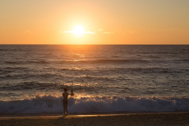 People enjoying their time at the sunrise on the beach