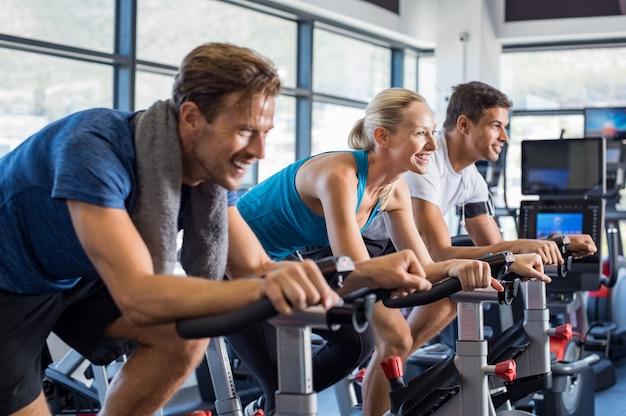 People on exercise bike
