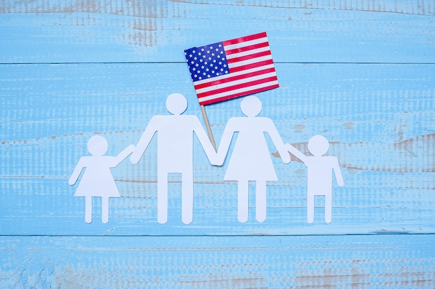 People or family paper shape with  flag of the united states of america