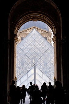 People at the gates of louvre museum