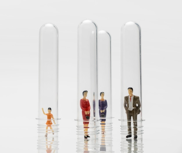 People in glass tubes during the coronavirus pandemic for protection