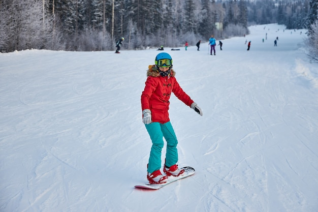 People go snowboarding and skiing, winter recreation and sports. skiing down the mountain on a snowboard, funny emotions on the faces of men and women