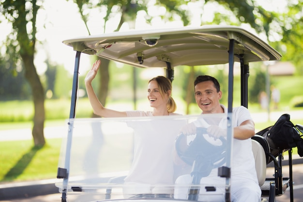 People in golf caddy car rich family hobby.