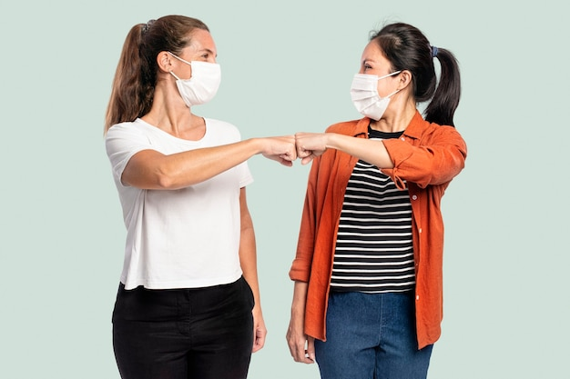 People greeting with elbow bumps for personal hygiene Free Photo