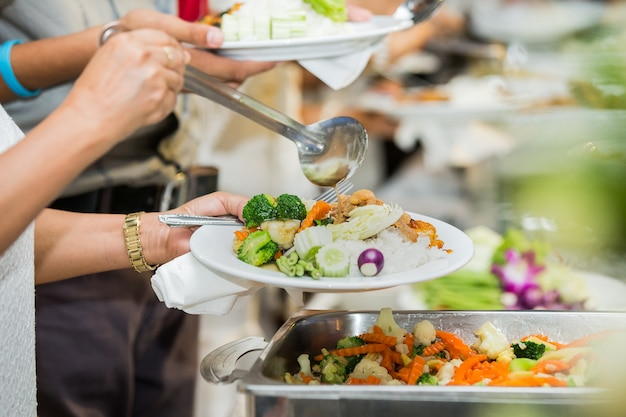People group catering buffet food indoor in luxury restaurant with meat colorful fruits and vegetabl