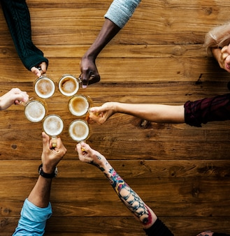 People hands hold beer alcohol drinks