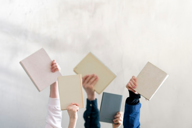 The people hands holding books, learning and studying, knowledge education Premium Photo