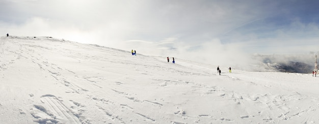 People having fun in snowed mountains in sierra nevada