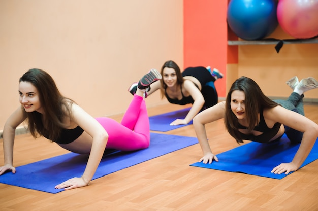 People at the health club with personal trainer