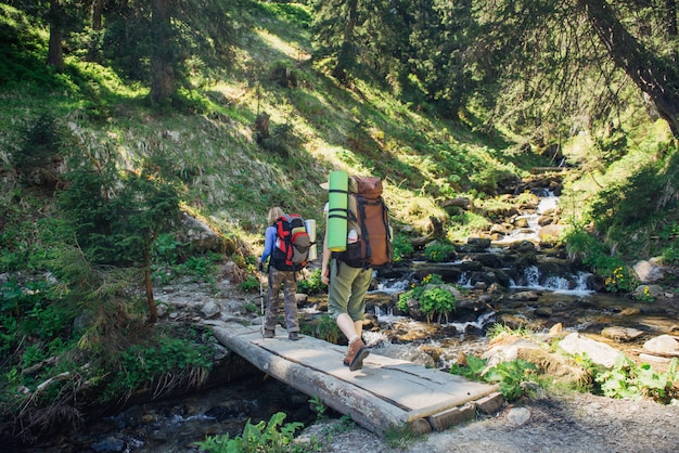 People hiking in carpathian mountains