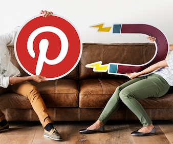 People holding a Pinterest icon