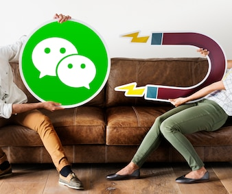 People holding a WeChat icon