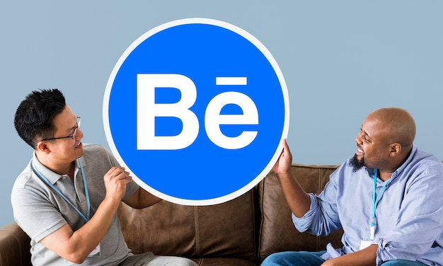 People holding the behance logo