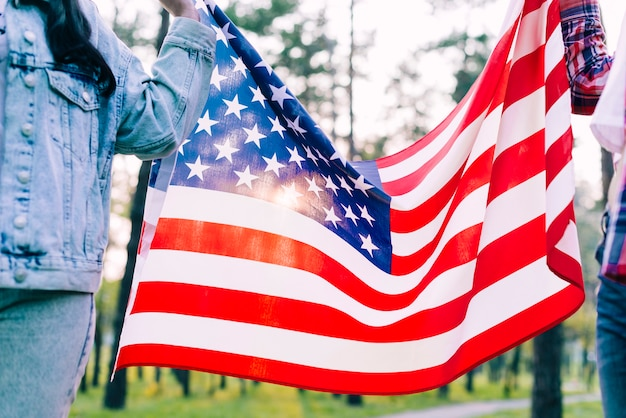 People holding flag of usa in park