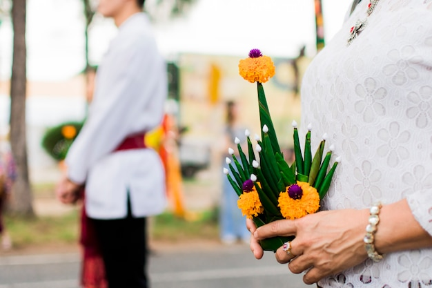 People holding groom or thai people call khan-mak-beng made from banana leaves and fresh flowers.