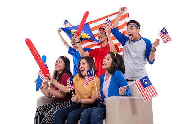 People holding malaysia flag celebrating malaysia super league