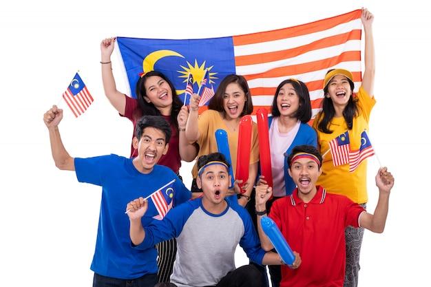People holding malaysia flag
