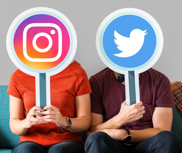 People holding social media icons