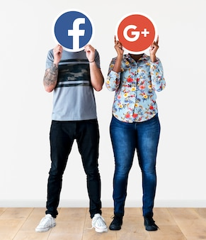 People holding two social media icons