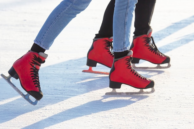 People ice skating on an ice rink. hobbies and leisure. winter sports