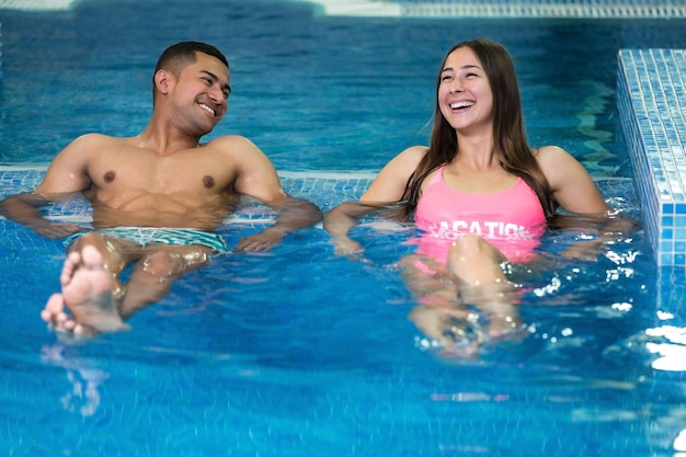 People laughing in pool