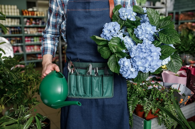 People lifestyle hobby person concept. portrait professional expert gardener holding showing garden flowerpot