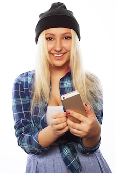 People, lifestyle and tehnology concept: pretty teen girl with smart phone - isolated on white