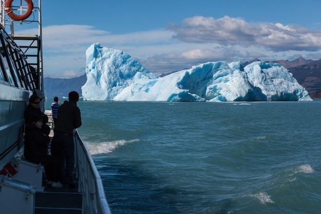 People look at iceberg