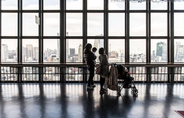 People looking at urban skyline