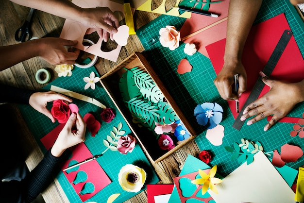 People making paper flowers craft art work handicraft