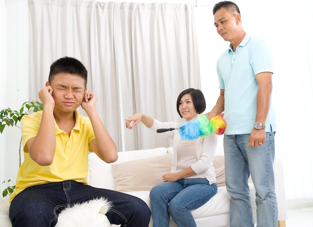 People, misbehavior, family and relations concept - upset or feeling guilty boy